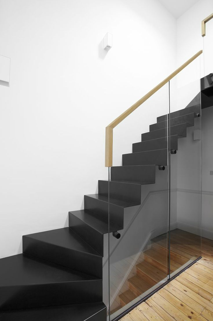 modern floating staircase / House in black, London