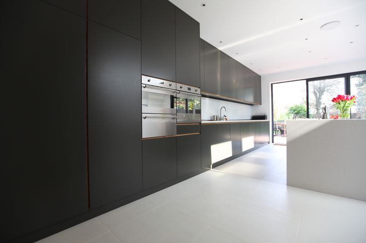 Modern Kitchen and extension. Black and white. Composite stone worktops and mat sprayed bespoke kitchen all by Alex Findlater. alexfindlater.com