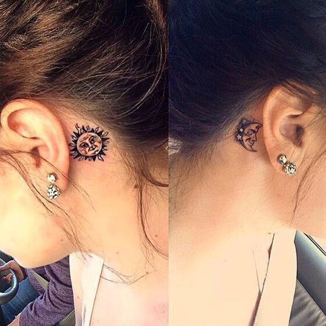 Sun/moon behind ear tattoos.