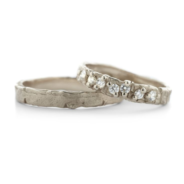 Wedding rings with a rugged structure. The setting of the diamonds adds to the uniqueness of the structure |  Trouwringen Wim Meeussen