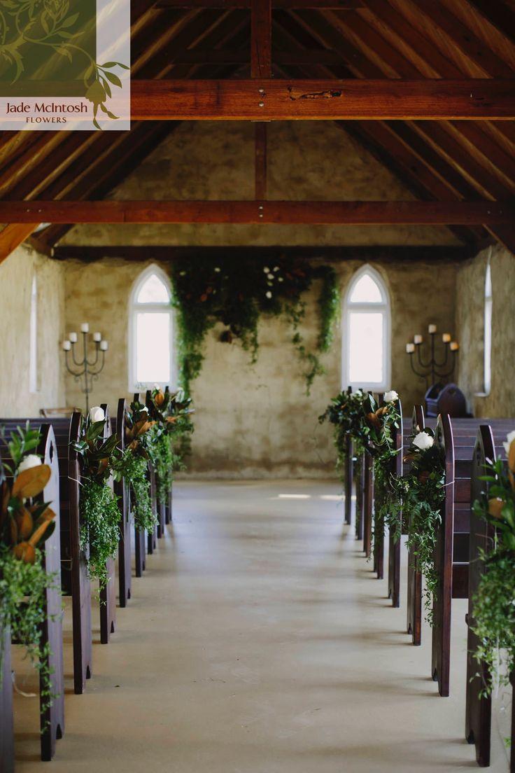 Trailing vine, magnolia foliage and white roses - the perfect way to finish off a country wedding chapel! www.jademcintoshflowers.com.au www.justinaaron.com.au
