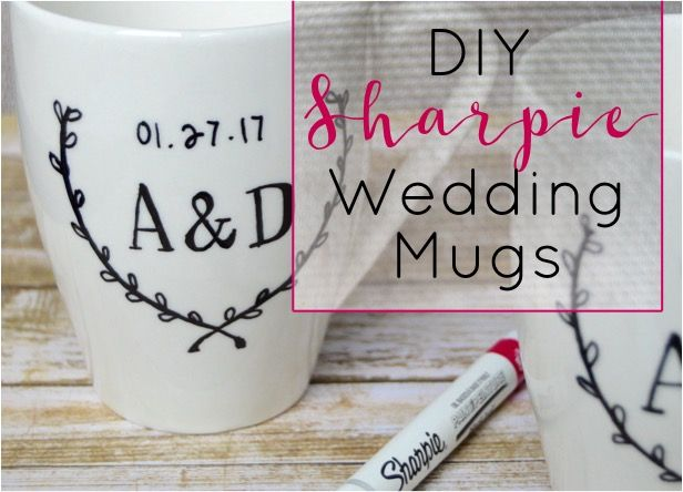 How to make DIY Sharpie mugs with the bride + groom 's initials / wedding date. DIY Sharpie wedding mugs is a cute + personalized wedding present craft idea