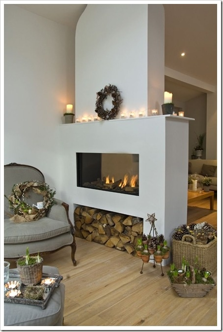 @Joni Wells Osborn - you could totally do this in your house! You don't need to take up a whole wall to have a cozy fireplace. Building out this wall makes the fireplace a decorative element and a handy partition between spaces.