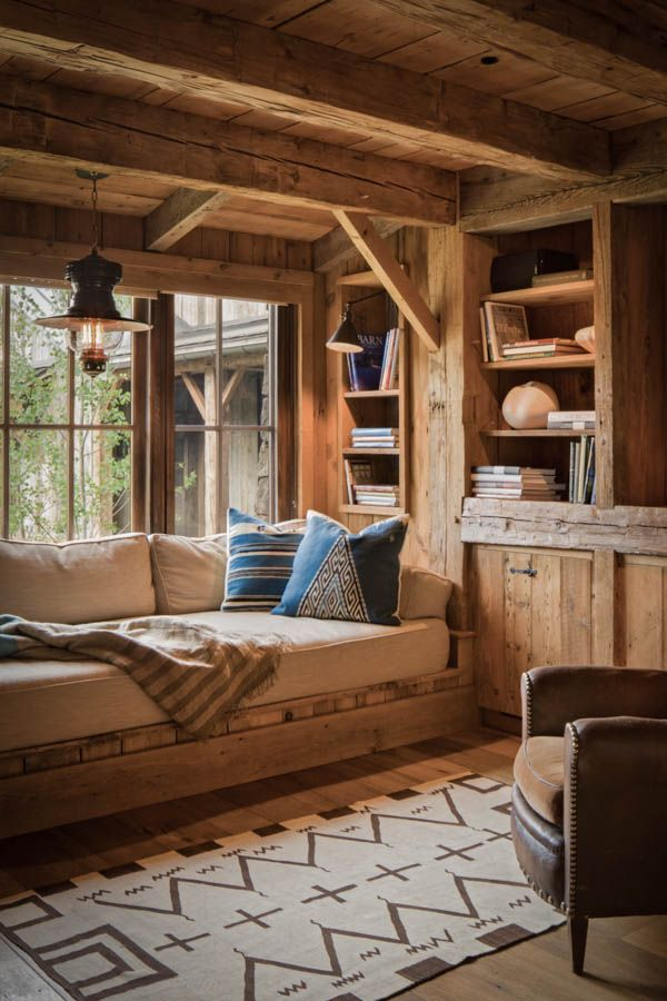 Built in day bed bookshelves in a window nook, timber fram style. Rustic and beautiful.