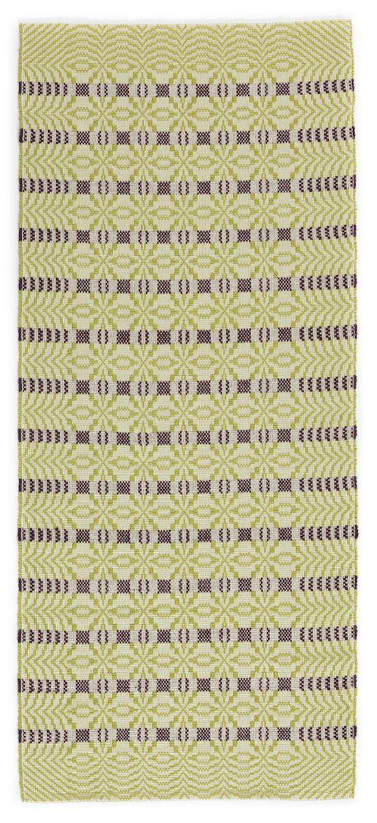 Tappeto  Tappeto in cotone e lana sarda con calibrata composizione geometrica a tutto campo di motivi ad intrecci in verde muschio su fondo neutro, con righe viola a scansione regolare.  Anna Deriu Bolotana