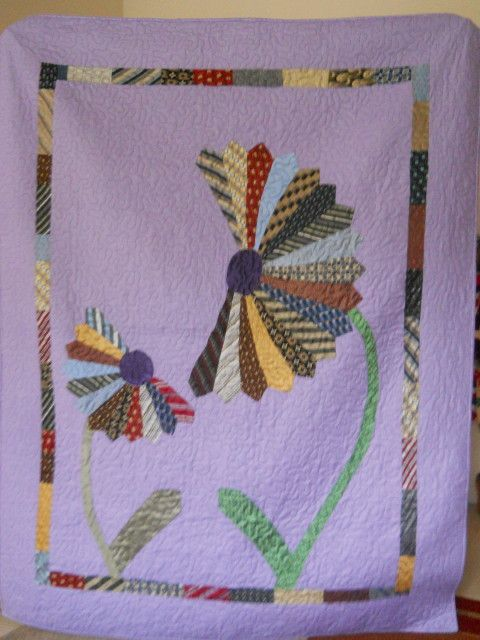 This is a quilt i made for a special young lady using her Daddy's ties.  He was killed in a car accident.