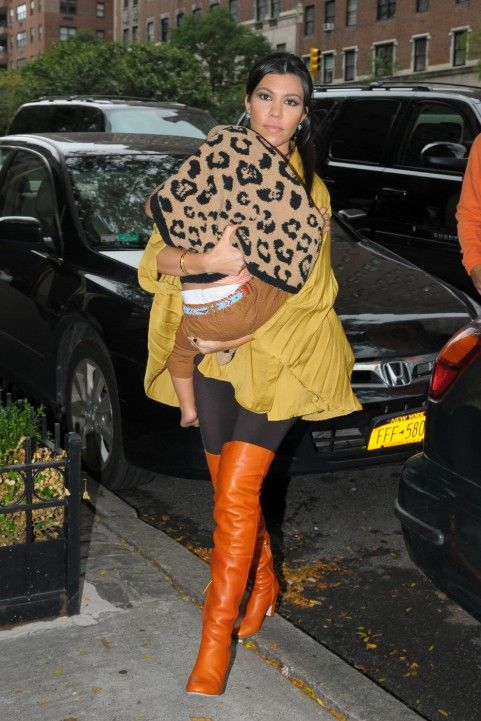I must have these fabulous orange boots! How much do you think thigh high Chanel boots cost anyway?