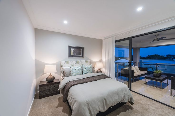 #Bedroom #interior #design #inspiration from #Ausbuild's Newbury display home. This #bedroom opens out onto a #large private balcony with a seamless flow from #indoor to #outdoor.