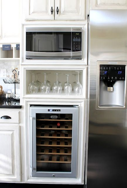 built in microwave (except hidden by drawer) and fridge (also hidden) with open countertop area next to this as pictured.