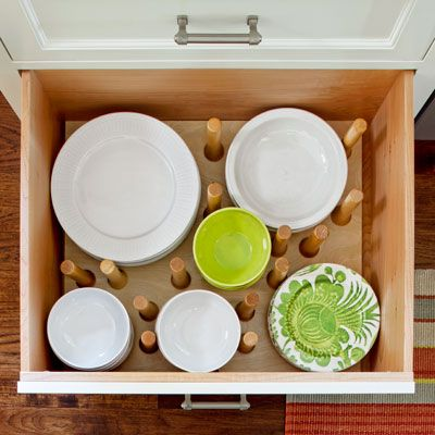 A dishware drawer is sectioned off with adjustable pegs | Photo: Paul Dyer | thisoldhouse.com