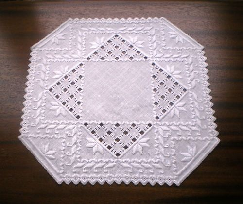 Beautiful Norwegian Hardanger Centerpiece with solid center. $39.95, via Etsy.