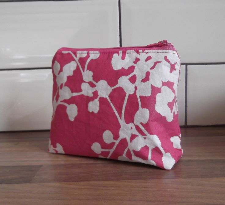 Coin purse using Amy Butler Belle Pink Coriander fabric.