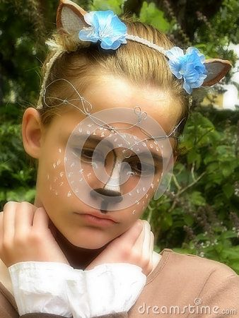 A view of a young girl dressed up as a sad fawn for Halloween.