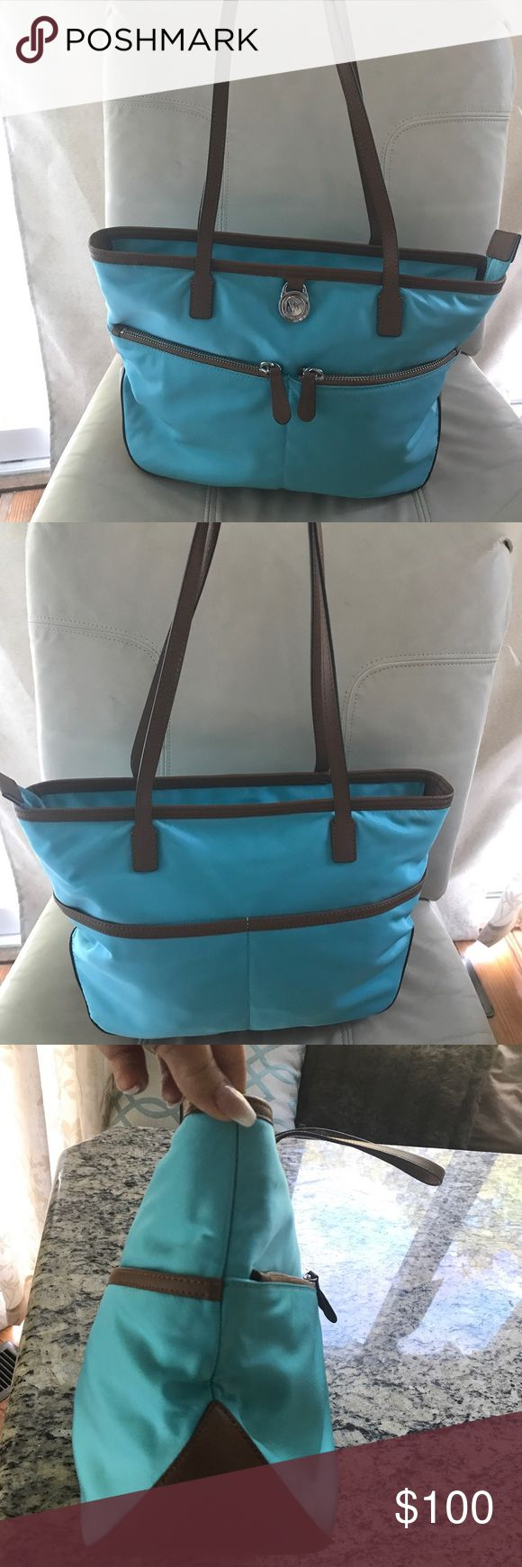 Michael Kors medium tote Gorgeous blue and brown medium Michael Kors tote. NWOT. Beautiful contrasting colors and lime green liner. This item is in perfect condition! Michael Kors Bags Totes