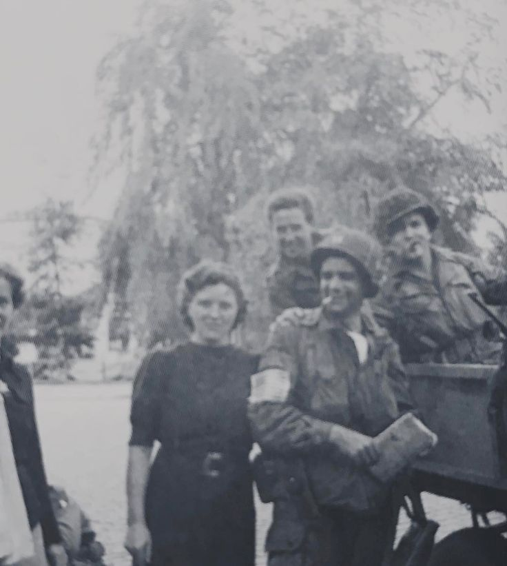 Lewis Nixon, in the front with the map and the cigarette, with other Second Battalion members and an unidentified woman
