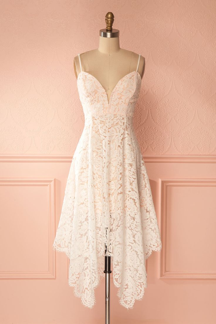 Josephina #Boutique1861 / For an outside event during the hotter seasons, this light lace dress will be a shoo-in. The pink colored lining stops mid-thighs, while the aerial lace falls gracefully down to below the knees. The thin straps are adjustable for a perfect fit.