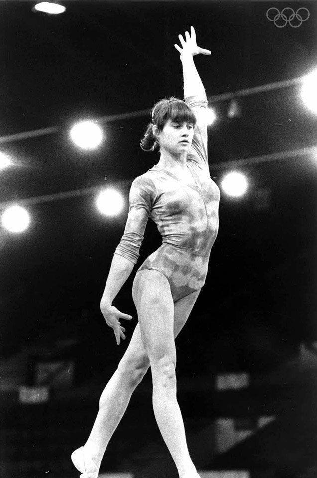 Romanian gymnast Nadia Comaneci performs a routine on the balance beam during the Summer Olympics, Montreal, Canada 1976. Comaneci was awarded seven perfect scores and three gold medals. (Photo by Hulton Archive/Getty Images)