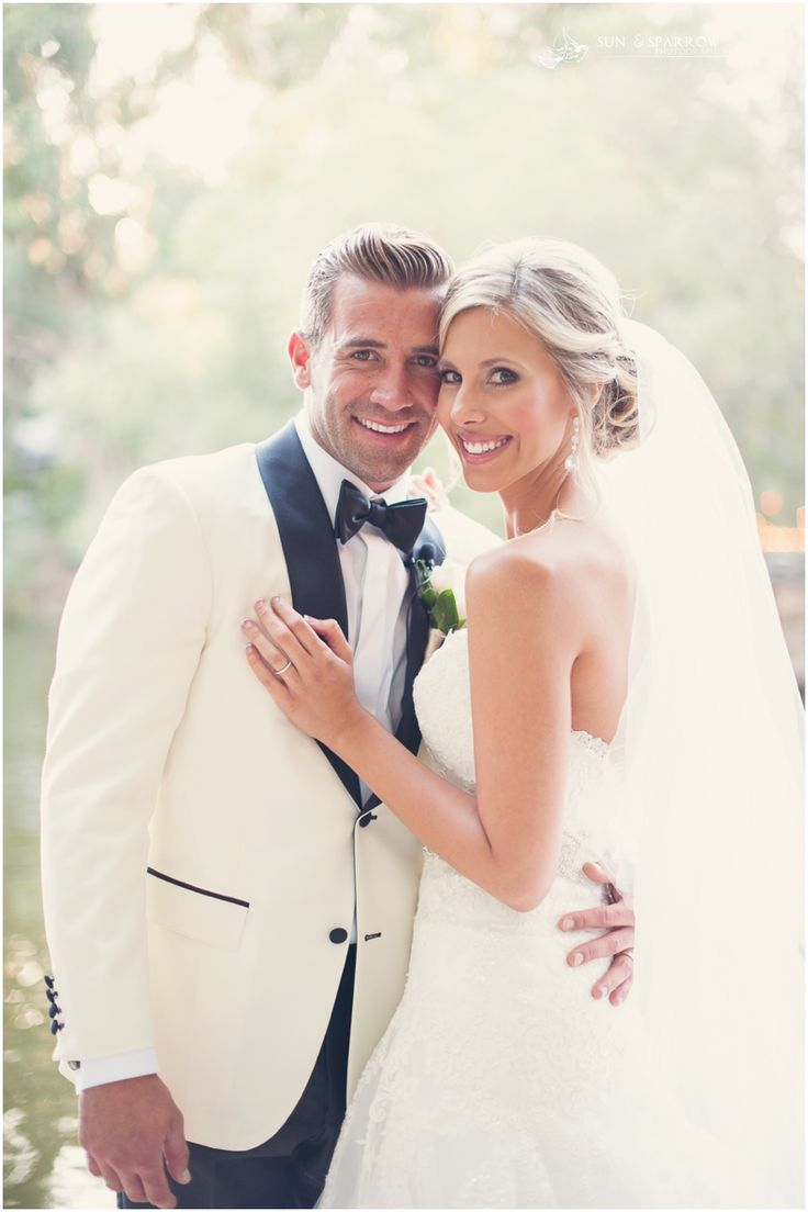 Up close look at a Black + White tux contrasted with all white bridal gown \\ Photo Credit: Sun and Sparrow Photography #blackandwhitewedding