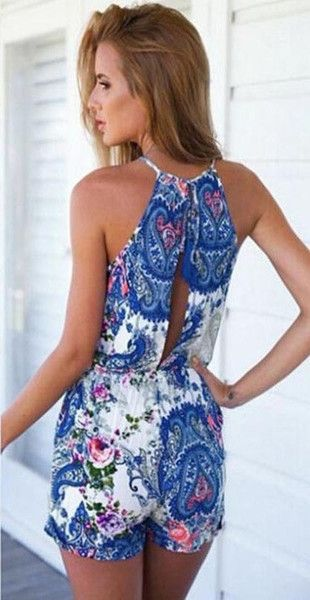 Blue Floral Romper - The elastic waistband helps to hug your curves, creating an alluring look which many rompers don't offer. the high neckline ties around the back of the neck, creating a luxurious effect.   The Flower Child floral playsuit is the perfect summer addition to your collection. This blue floral romper is super soft and comfy yet classy at the same time. The bright patterns are gorgeous and the mix of hues is perfect for any skin tone. #romper