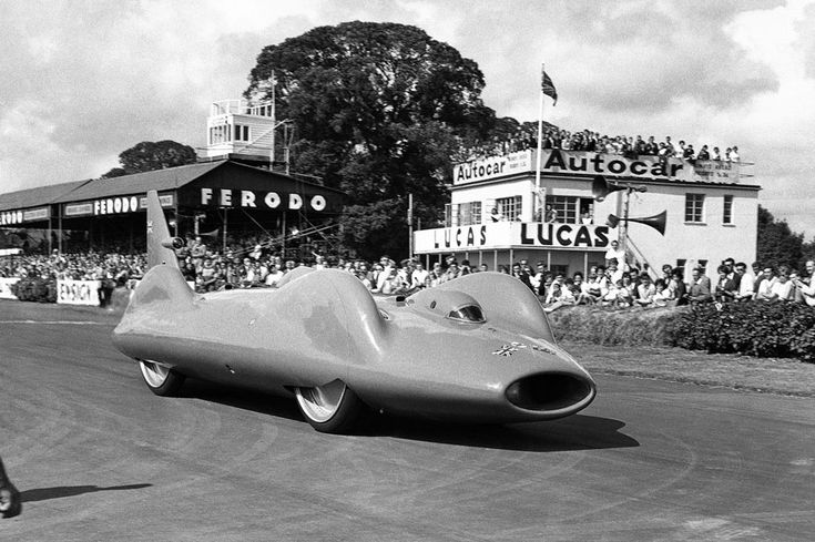 Donald Campbell's rebuilt Bluebird, the car in which he plans to make an attempt on the world land speed record on Lake Eyre, Australia, in Spring 1963 on show to the public for the first time as he drives it round the Goodwood Circuit, on July 14, 1962 at the Goodwood Festival of Motoring in Sussex, England. In 1964, Campbell set a record of 403.10 mph