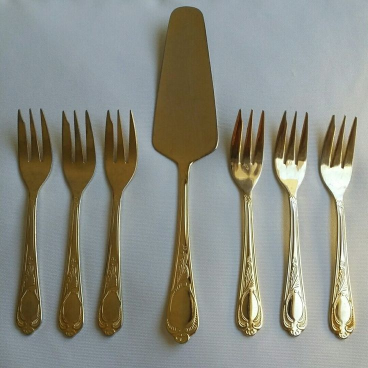 "SBS BESTECKE SOLINGEN ""WIEN"" Pattern Cutlery. X1 23/24 Karat Gold Plated Cake Slice and 6 cake forks.   Items are in good condition - used. Some light signs of wear / use."