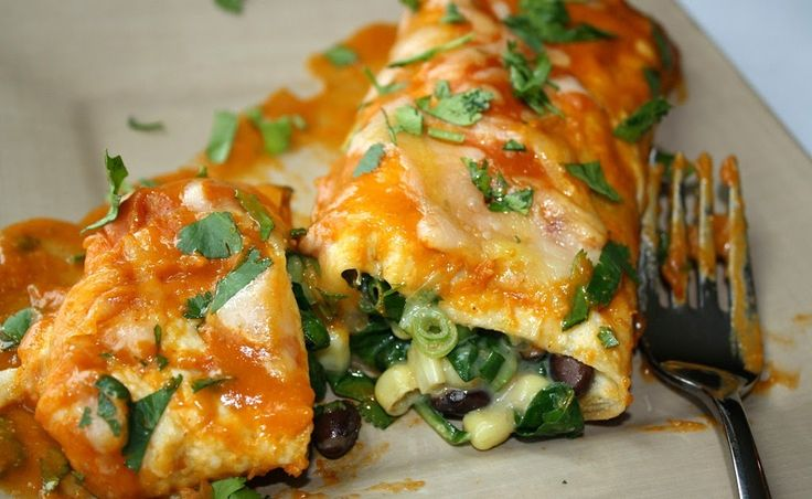 Black Bean and Spinach Enchiladas. Super easy and topped with an amazing homemade enchilada sauce! (vegan) | The Garden Grazer.