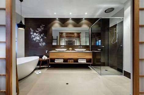dark wall, wood cabinet warm floor, white tub/walls, wood glass doors