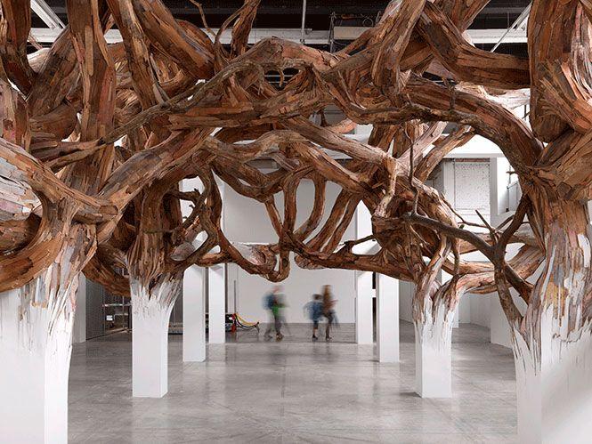 Henrique Oliveira - Baitogogo / 2013 / Palais de Tokyo, Paris - France, plywood and tree brunchs / 6,74 x 11,79 x 20,76m / photo: Andre Morin