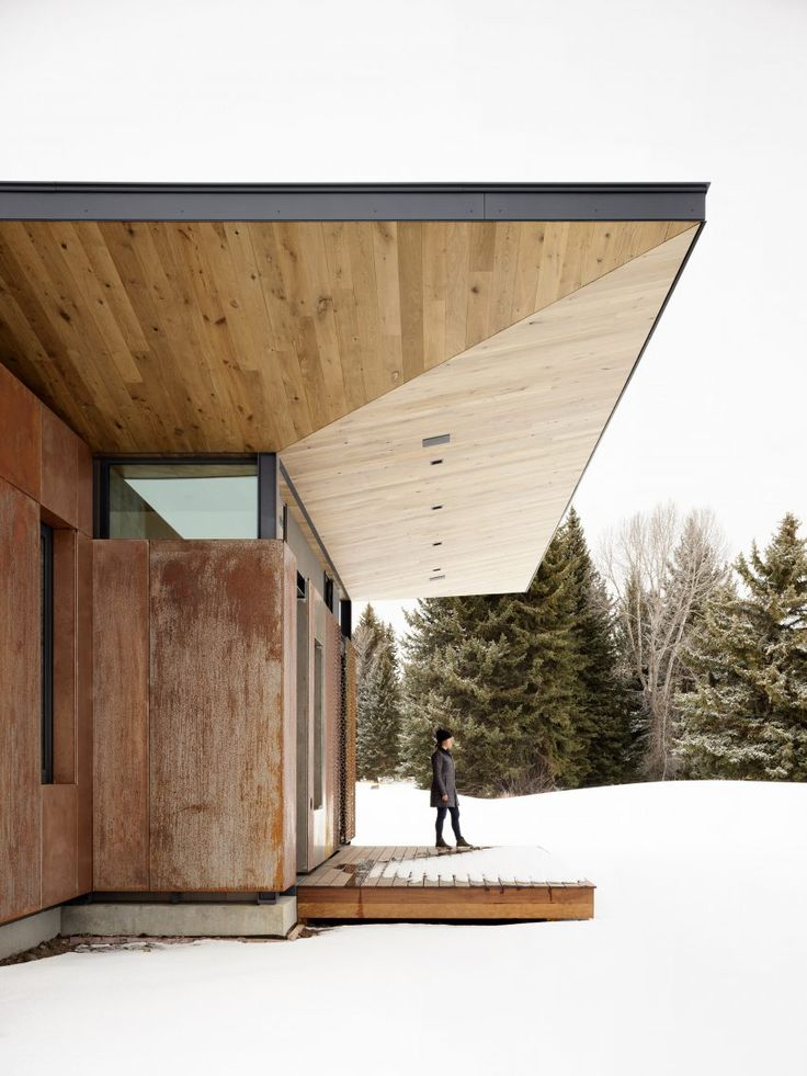 L-shaped in plan, the house follows the footprint …