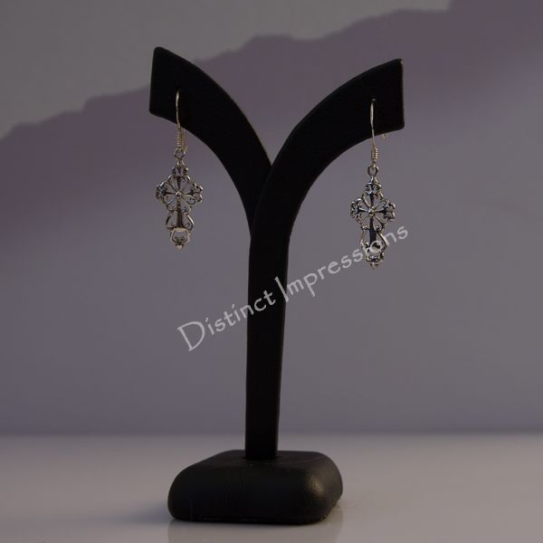 These Filigree Cross Sterling Silver earrings will definitely add a touch of style and class to your outfit.