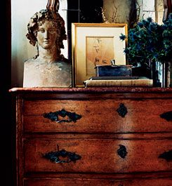 beautiful antique chest. great arrangement. Ralph Lauren. A stepmother of mine decorated like this. Wasn't my style at all but she always made it beautiful. Love the juxtaposition of old and new.
