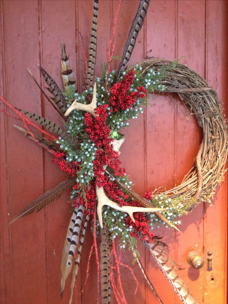 Christmas wreaths with antlers and feathers