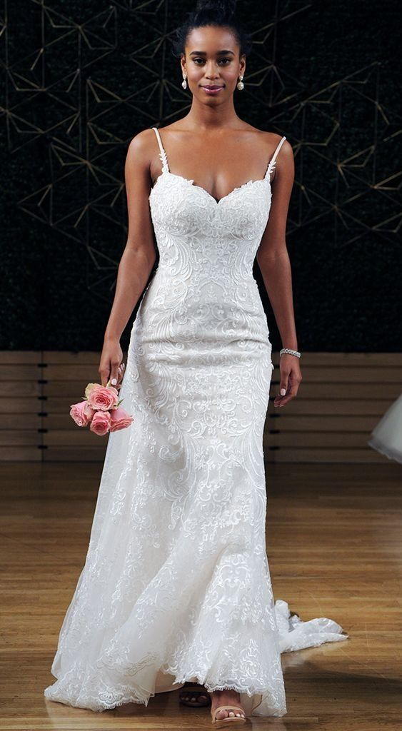 Rebecca Ingram Debbie | Swirls of romantic lace motifs dance over textured tulle in this fit-and-flare gown, complete with sweetheart neckline and beaded spaghetti straps. #fittedweddingdress #thinstrapdress #weddingdress