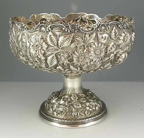 A Stieff repousse sterling silver centerpiece bowl hand chased with flowers and leaves against a fine stippled background.