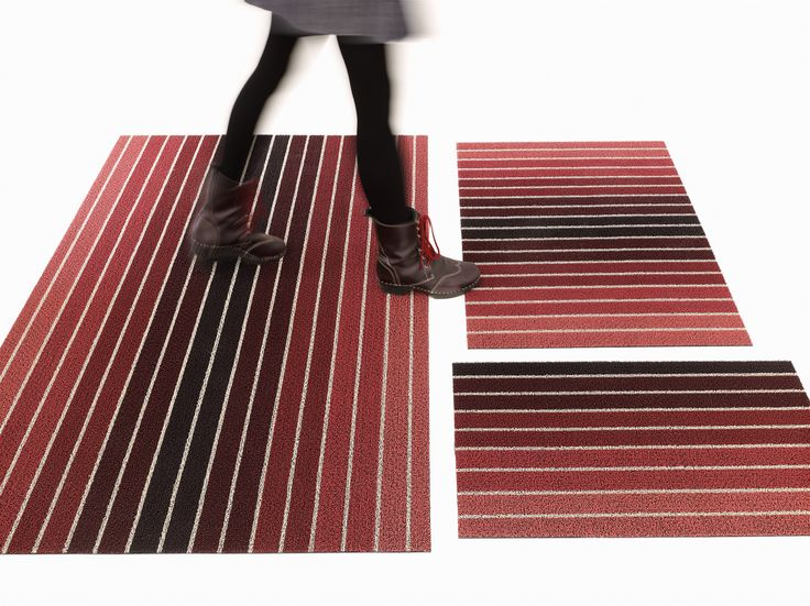 The Block Stripe Shag floor mat is a completely new layout design for the Shag collection, featuring a gradient from burgundy to rust pink that gives the overall impression of a muted, warm red that has been left out in the sun. The alternating white stripes reference a designer's color study, recalling paint swatches or color palette research. Offered in three sizes: doormat, utility mat and big mat. Good in all weather. Quick to dry. Mold, mildew and chlorine resistant.