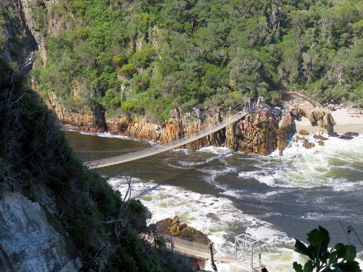 Tsitsikamma Suspension Bridge  Spanning 77 metres, and hanging 7 metres above the swirling waters of the Storms River, the Tsitsikamma suspension bridge is one of the most popular tourist attractions in the Eastern Cape.  Where to stay in Storms River / Tsitsikamma https://goo.gl/WEn31v   @StephanieMarthi Twitter