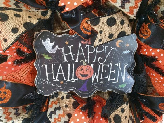 Happy Halloween!  This adorable wreath is made on a black work wreath frame with burlap fabric and black, and orange paper mesh ruffles, burlap and black polka dot ribbon, glitter halloween chevron ribbon, glitter halloween pumpkin ribbon and orange and white polka dot ribbon. The finishing touch is a cute happy halloween chalkboard sign.  All of my wreaths are made out of paper mesh. They can be used on a front door. During inclement weather, I would recommend bringing your wreath inside…