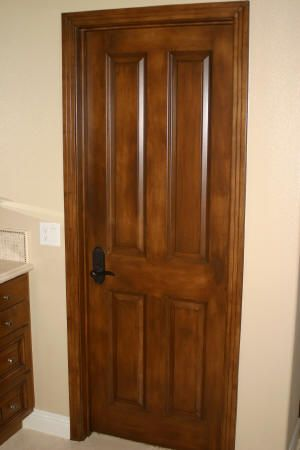 Faux Doors: glaze a white door to look like wood
