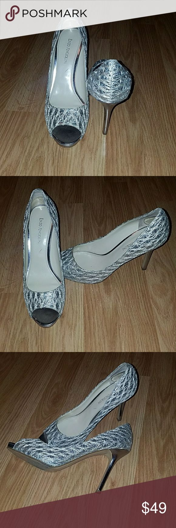 Enzo Angiolini Silver Peep Toe Heels Beautiful, silver peep toes. 3.5 in. Heel. Wore these one time at a wedding. You can see wear on the soles of the shoes but no other signs of wear on the actual shoe or heel (see pics).  Size down a 1/2 size.  I usually wear 7.5 or 8 but definitely needes the 7.5 in this shoe. Enzo Angiolini Shoes Heels