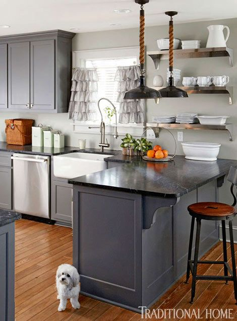 Vintage lamp parts and heavy rope make the light fixtures in this gray kitchen - Traditional Home® / Photo: Colleen Duffley / Design: Paige Sumblin Schnell & Anna Kay Porch