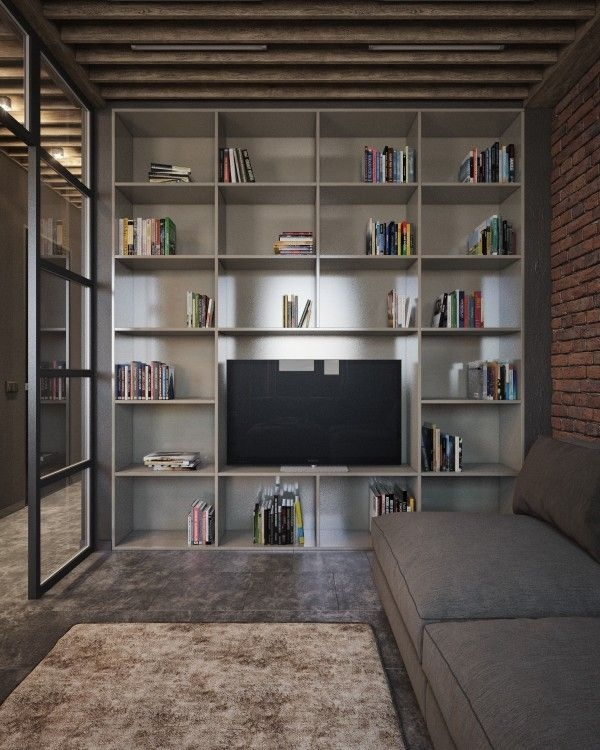 The play with texture can be seen here too with open shelving in a smooth media center, a textured floor of tile and carpet, and a contemporary couch set against the exposed brick.