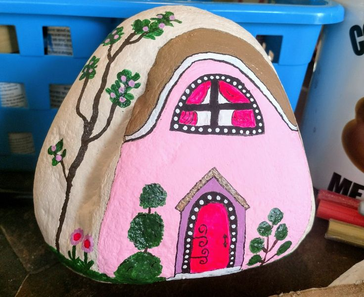 Pink house painted rock