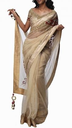 Classic Satya Paul Saree with a modern style of embelishment incorporating brushstrokes of sequins.    Satya Paul´s contemporary Indian styles of Sarees is unsurpassed within the Indian Fashion world. His Saree lines range from Silk Sarees to Net sarees with rich embroidery. Satya Paul as a designer is one of the most popular Indian designers in Bollywood. Strand of Silk (strandofsilk.com) offers a beautiful collection of Satya Paul Sarees with beautiful coloured prints.