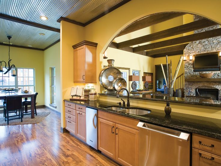 Well designed kitchen overlooking the charming great room for Open country kitchen floor plans