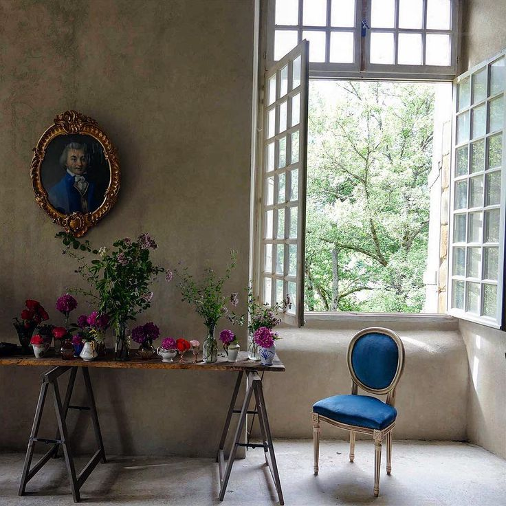 Royal blue upholstered Louis dining chair and trestle table with fresh flowers. South of France Fixer Upper Château Gudanes. #southoffrance #frenchchateau #provence #frenchcountry #renovation