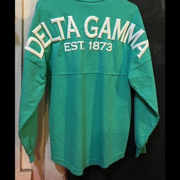 Delta Gamma Spirit Jersey-NWT Delta Gamma Sorority Long Sleeve Shirt- Seafoam- Size Medium- New! Over-sized fit White back print with Delta Gamma on the curve Est. 1873 Color: Seafoam Made with 100% High Quality Cotton- Pre Shrunk Front is blank to allow for personalization Size- Medium  New! Ships in one business day! Spirit Jersey Tops Tees - Long Sleeve