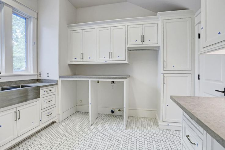 3618 Amherst St West University Place, TX 77005: Photo If not the best laundry room in West U it is one of the bests!  It is quite spacious and has fabulous sink area, multitude of built-ins and counter space and is spacious storage closet.  The windows fill it with sunshine!