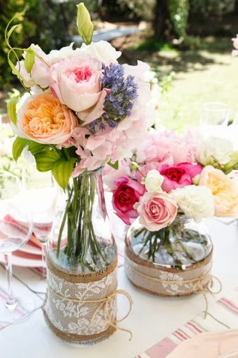 Centerpieces - Pretty Garden party flowers / Bottles with lace, Burlap, and twine. Arrangements / table setting