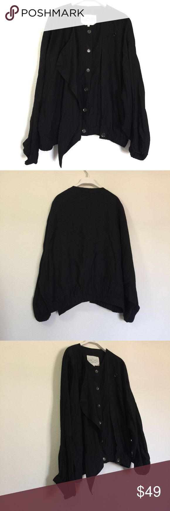 """Rachel Roy Black Converitble Cape Vest Jacket L Rachel Roy Black Converitble Cape Vest Jacket, excellent condition. Inner button down vest with draping sleeves and elastic waistband. Cape has draping dolman sleeves and a button front for colder days. Pit to pit 21"""", length 23.5"""", waist 18.5"""". Rayon blend. RACHEL Rachel Roy Jackets & Coats Capes"""