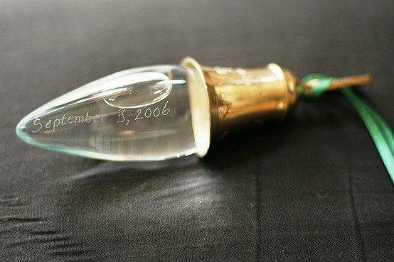 If it rains on your wedding day--collect the rain and save it for an ornament in a recycled lightbulb!!